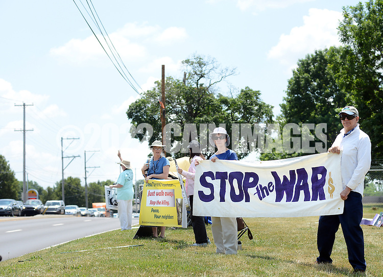Protestors hold banners during an anti drone protest at the Horsham Drone Command Center Saturday June 25, 2016 at the old Willow Gove Naval Air Station in Horsham, Pennsylvania. (Photo by William Thomas Cain)