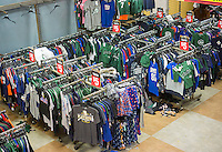 Racks of bargain merchandise in the Modell's Grand Central location in New York on Wednesday, February 18, 2015. After 25 years there is only one week to go after the loss of its lease due to the construction of a skyscraper as part of redevelopment of Midtown East.  Several other retailers have already vacated. (© Richard B. Levine)