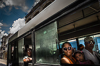 Havana, Cuba, sept 2014. Daily scene in the streets of a neighborhood named Center Havana.                In recent years, Raul Castro has made several economic measures for the people of the island. Cubans can now buy and sell apartments or cars, can stay in hotels on the island and can travel abroad with minor difficulties. Most of the global economists believe that these changes are moving in the right direction but its positive effects on people are very slow. Cubans continue to struggle daily through the streets of Havana with humor and zest for life.                                  En los ultimos años Raul Castro ha realizado varias medidas economicas para el pueblo de la isla. Ahora los cubanos pueden comprar y vender departamentos o coches, pueden alojarse en hoteles de la isla y pueden viajar al extranjero con menores dificultades. La mayor parte de los economistas mundiales consideren que estos cambios se mueven en la justa direccion pero sus efectos positivos sobre la gente son muy lentos. Los cubanos siguen luchando a diario por las calles de La Habana con humorismo y ganas de vivir.