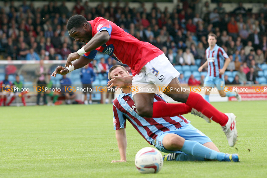 Eddie Nolan of Scunthorpe United brings down Femi Ilesanmi of Dagenham and Redbridge - Scunthorpe United vs Dagenham and Redbridge  at the Glanford Park Stadium - 17/08/13 - MANDATORY CREDIT: Dave Simpson/TGSPHOTO - Self billing applies where appropriate - 0845 094 6026 - contact@tgsphoto.co.uk - NO UNPAID USE