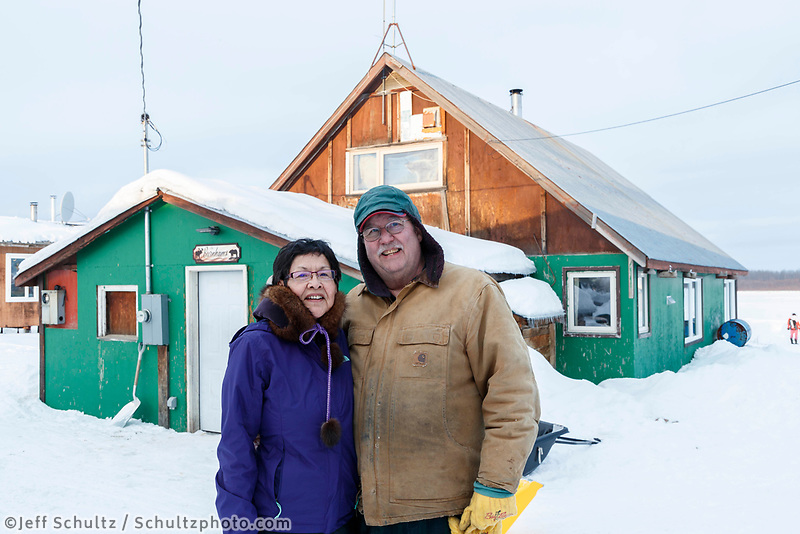 Richard and Violet Burnham pose for a photo outside their home, which was used as the Iditarod checkpoint for many of the first races.   during the 2017 Iditarod on Saturday afternoon March 11, 2017.<br /> <br /> Photo by Jeff Schultz/SchultzPhoto.com  (C) 2017  ALL RIGHTS RESERVED