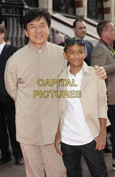 "JACKIE CHAN & JADEN SMITH.The Gala Premiere of ""The Karate Kid"", Odeon Leicester Square, London, England, UK. .15th July 2010 .half 3/4 length white cream beige jacket sunglasses shirt black trousers suit trainers hand in pocket.CAP/CAN.©Can Nguyen/Capital Pictures."