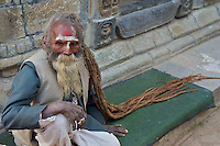 Old Sadhu with very long hair at Shambhu Nath Hindu traditional Cremation Area, Kathmandu, Nepal