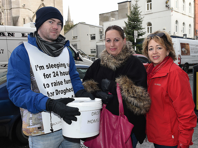 Sandra and Louise Conaghy gives a donation to Alan cassidy who is taking part in the 24 hour sleep out to raise funds for Drogheda Homeless aid. Photo:Colin Bell/pressphotos.ie