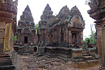 Angkorian temple Banteay Srei (late 10th century) 967.<br /> Part of east side of southern library on left looking towards doorway into southern tower sanctuary.Doorway on right into Mandapa and central tower sanctuary.Part of south side of Gopura II. <br /> The central sanctuary and the southern sanctuary were dedicated to Shiva and the northern sanctuary was dedicated to Vishnu.<br /> Banteay Srei temple is situated 20km north of Angkor, built during the reign of Rajendravarman by Yajnavaraha, one of his counsellors. In antiquity Isvarapura was a small city that grew up around the temple. Banteay Srei was dedicated to the worship of Shiva, the foundation stele describes the consecration of the linga Tribhuvanamahesvara (Lord of the three worlds) in 967.
