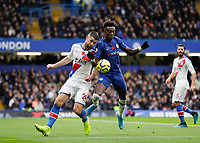 9th November 2019; Stamford Bridge, London, England; English Premier League Football, Chelsea versus Crystal Palace; Gary Cahill of Crystal Palace challenges Tammy Abraham of Chelsea  - Strictly Editorial Use Only. No use with unauthorized audio, video, data, fixture lists, club/league logos or 'live' services. Online in-match use limited to 120 images, no video emulation. No use in betting, games or single club/league/player publications