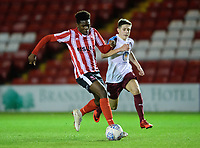 Lincoln City U18's Timothy Akinola vies for possession with South Shieldsy U18's Ollie Scott<br /> <br /> Photographer Chris Vaughan/CameraSport<br /> <br /> The FA Youth Cup Second Round - Lincoln City U18 v South Shields U18 - Tuesday 13th November 2018 - Sincil Bank - Lincoln<br />  <br /> World Copyright © 2018 CameraSport. All rights reserved. 43 Linden Ave. Countesthorpe. Leicester. England. LE8 5PG - Tel: +44 (0) 116 277 4147 - admin@camerasport.com - www.camerasport.com
