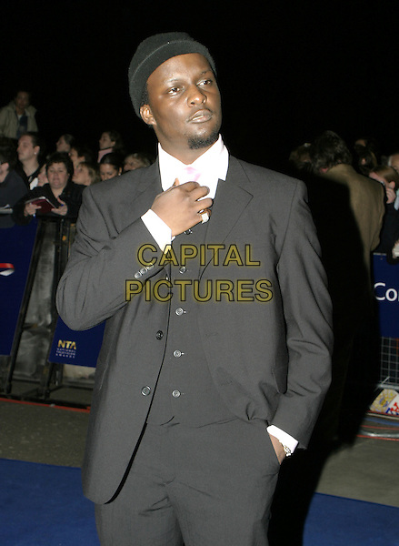 VICTOR - BIG BROTHER.National TV Awards, Royal Albert Hall.October 26th, 2004.half length, adjusting tie, gesture, three piece suit.www.capitalpictures.com.sales@capitalpictures.com.© Capital Pictures.