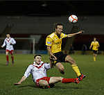 Airdrie's Chris O'Neill tackles Iain Russell