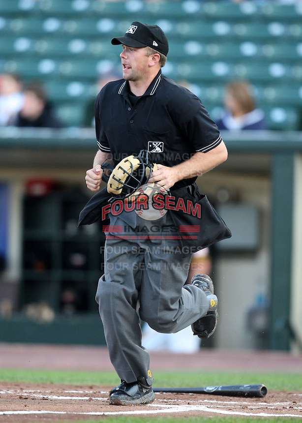 May 16, 2010:  Home plate umpire Travis Brown during a game between the Rochester Red Wings and Charlotte Knights at Frontier Field in Rochester, PA.  Charlotte defeated Rochester 9-2.  Photo By Mike Janes/Four Seam Images