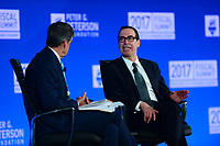 Washington, DC - May 23, 2017: U.S. Treasury Secretary Steven Mnuchin participates in a discussion with CNBC's John Harwood during the 2017 Fiscal Summit, hosted by the Peter G. Peterson Foundation, at the Andrew Mellon W. Mellon Auditorium in the District of Columbia May 23, 2017.  (Photo by Don Baxter/Media Images International)