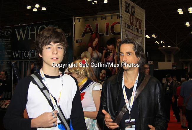 """General Hospital Michael Easton (One Life To Live, Port Charles, Days of Our Lives) poses with All My Children JQ DePaiva (son of Kassie and James) at the New York Comic Con 2012 to show fans and others """"Soul Stealer Collector's Edition"""" which he cowrote and  was in a booth with Christopher Shy on October 13, 2012 at the Javits Center, New York City, New York. (Photo by Sue Coflin/Max Photos)"""