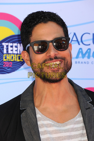 Adam Rodriguez.Teen Choice Awards 2012 - Arrivals held at Gibson Amphitheatre, Universal City, California, USA..July 22nd, 2012.headshot portrait black grey gray jacket beard sunglasses shades facial hair smiling .CAP/ADM/BP.©Byron Purvis/AdMedia/Capital Pictures.