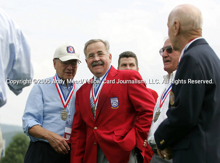 Hank Steinbrecher (in red), a 2005 inductee, is surrounded by returning members of the Hall of Fame on Monday, August 29, 2005, in the Hall of Fame game played after the 2005 National Soccer Hall of Fame Induction Ceremony in Oneonta, New York. The Colorado Rapids defeated DC United 6-2.