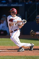 Tyler Holt #15 of the Florida State Seminoles follows through on his swing versus the Boston College Eagles at Durham Bulls Athletic Park May 20, 2009 in Durham, North Carolina. (Photo by Brian Westerholt / Four Seam Images)