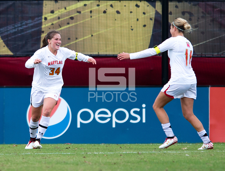 Danielle Hubka (34) of Maryland celebrates her game-winning goal as teammates close in during the game at Ludwig Field in College Park, MD.  Maryland defeated Miami, 2-1, in overtime.