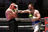 Lucas Robinson (white/blue shorts) defeats Richard Harrison during a Boxing Show at York Hall on 10th June 2017