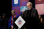 Rev. Craig Mousin, an ordained Protestant minister and DePaul's organizational ombudsperson, offers the invocation at the DePaul University College of Law commencement ceremony, Sunday, May 14, 2017, at the Rosemont Theatre in Rosemont, IL, where some 240 students received their Juris Doctors or Master of Laws degrees. (DePaul University/Jeff Carrion)