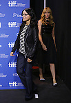 """Julia Louis-Dreyfus and Toni Collette attending the 2013 Tiff Film Festival Photo Call for """"Enough Said""""  at the Tiff Lightbox  on September 8, 2013 in Toronto, Canada."""