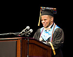 WATERBURY, CT-062017JS15- Waterbury Career Academy graduate Nolan Pimental is all smiles as someone screams out &quot;That's my boy&quot; during graduation ceremonies Tuesday at the Palace Theatre in Waterbury. <br /> Jim Shannon Republican-American