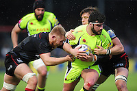 Rob Webber of Sale Sharks is double-tackled by Jackson Wray and Michael Rhodes of Saracens. Aviva Premiership match, between Saracens and Sale Sharks on February 25, 2017 at Allianz Park in London, England. Photo by: Patrick Khachfe / JMP