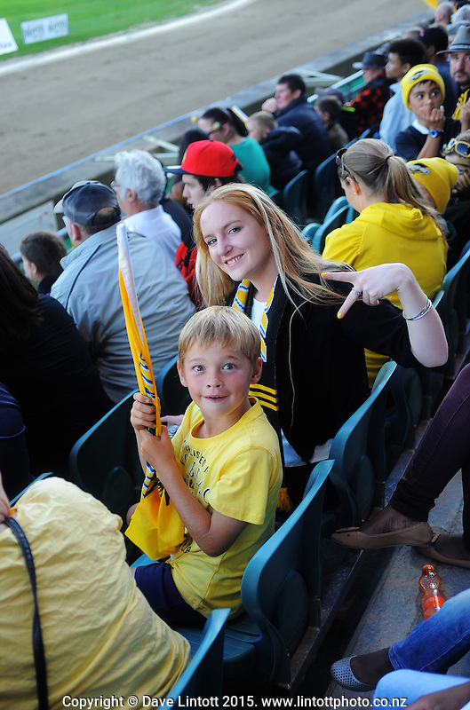 Fans in the grandstand during the Super Rugby match between the Hurricanes and Blues at FMG Stadium, Palmerston North, New Zealand on Friday, 13 March 2015. Photo: Dave Lintott / lintottphoto.co.nz