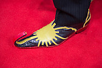 RAJIVE ANAND, from NYC, is Laserman at the 10th Annual New York Comic Con, and closeup of his colorful red, yellow and black leather shoe shows toe curling up and back. NYCC 2015 is expected to be the biggest one ever, with over 150,000 attending during the 4 day ReedPOP event, from October 8 through Oct 11, at Javits Center in Manhattan