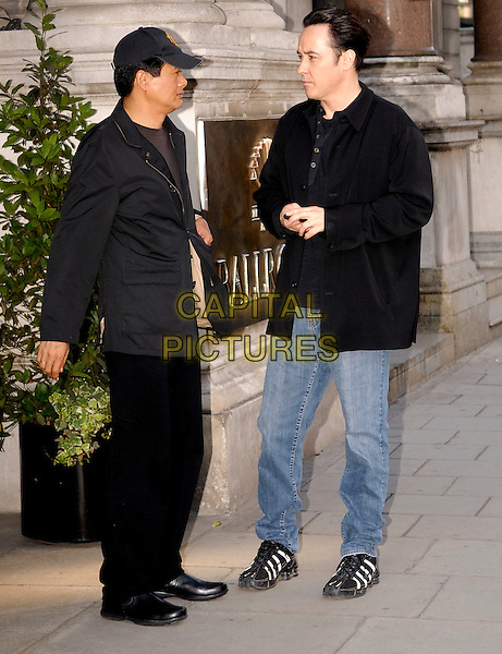 "CHOW YUN FAT & JOHN CUSACK.The cast of ""Shanghai"" at the Mandarin Hotel, London, England..June 17th, 2008.full length black jacket baseball cap hat jeans denim profile .CAP/IA.©Ian Allis/Capital Pictures."