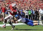 LINCOLN, NE - SEPTEMBER 21, 2013:  Imani Cross #32 of Nebraska gets a touchdown past South Dakota State tackler Andrew Brown #15 during their college football game Saturday at Memorial Stadium in Lincoln, NE.  (Photo by Dick Carlson/Inertia)