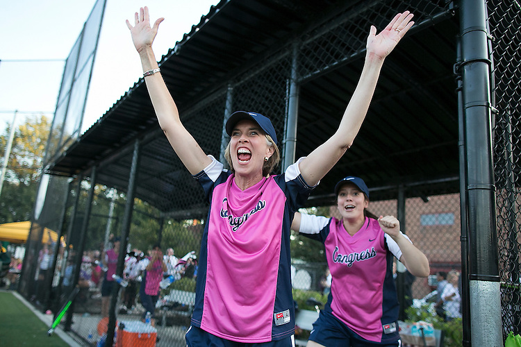 UNITED STATES - JUNE 24 - Rep. Katherine Clark, D-Mass., throws her hands in the air in celebration as she runs out in front of Rep. Elise Stefanik, R-N.Y., as they win the seventh annual Congressional women's softball game 1-0 near Capitol Hill in Washington D.C. on Wednesday, June 24, 2015. (Photo By Al Drago/CQ Roll Call)