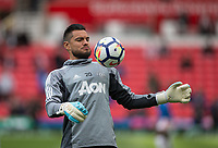 Goalkeeper Sergio Romero of Man Utd warms up ahead of the Premier League match between Stoke City and Manchester United at the Britannia Stadium, Stoke-on-Trent, England on 9 September 2017. Photo by Andy Rowland.