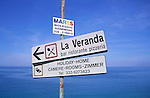 Italian language sign for tourist services with coastal background of blue sea and sky, Sicliy, Italy