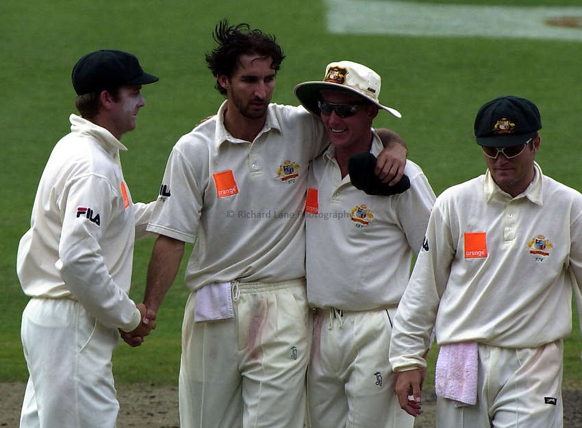 Photo. Steve Holland. .England V Australia Ashes Melbourne Day Four.Sunday 29 December 2002.Australia's L to R  Martin Love, Jason Gillespie, Brett Lee, and Stuart McGill leave the field after England were all out on the fourth day of the Boxing day Test against England.