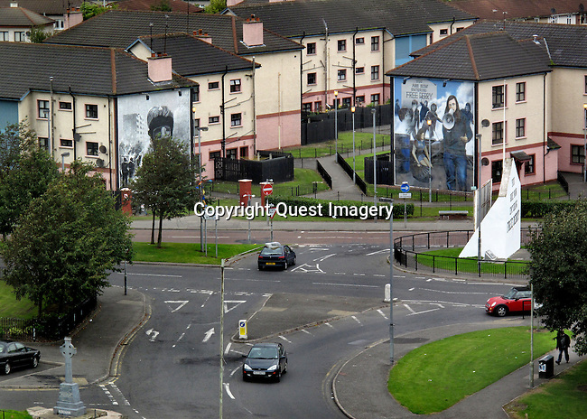 A view of the Rossville Flats with some of  the murals by The Bogside Artists.  The  artists are a trio of mural painters from Derry, Northern Ireland, consisting of Tom Kelly, his brother William Kelly, and Kevin Hasson. &quot;The People's Gallery&quot; series is their most famous murals.<br />
