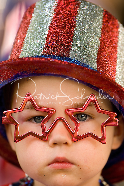 A youngster sports festive glasses and hat at the annual Fourth of July Celebration and community parade in Birkdale Village in Huntersville, NC. Birkdale Village combines the best of shopping, dining, apartments and entertainment venues within a 52-acre mixed-use development.