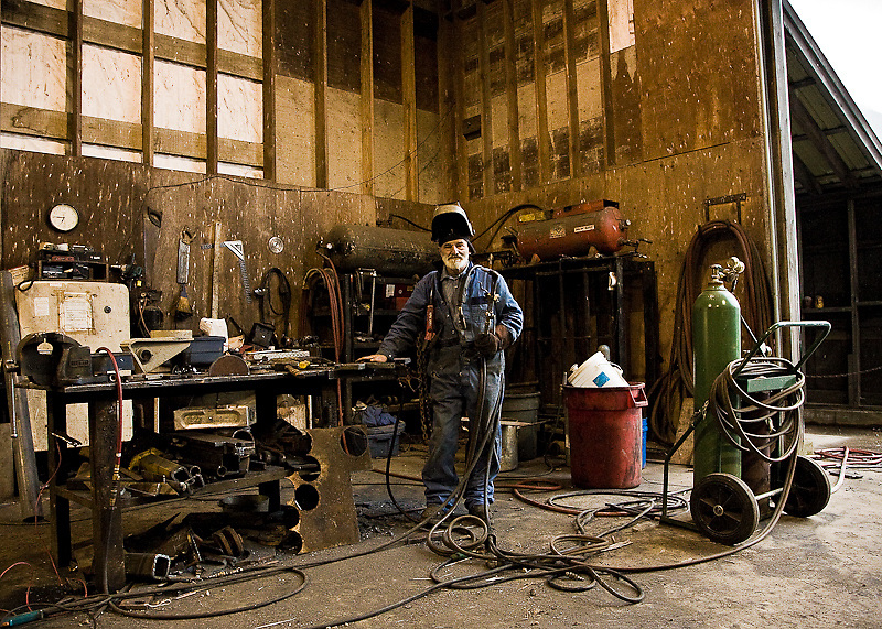 "George Bellavance, considered by some the ""best welder-fabicator in the region."" An indispensable set of skills and arts in a coastal logging camp. Stafford Lake, June 2008."