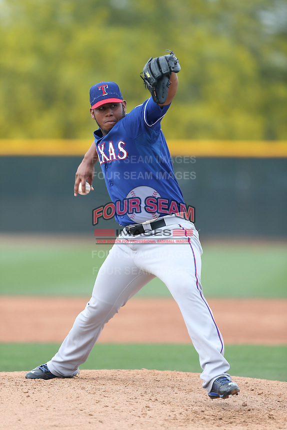 Armando Rodriguez #62 of the Texas Rangers pitches during a Minor League Spring Training Game against the Kansas City Royals at the Kansas City Royals Spring Training Complex on March 20, 2014 in Surprise, Arizona. (Larry Goren/Four Seam Images)
