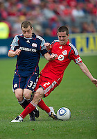 22 May 2010: New England Revolution defender Zak Boggs #33 and Toronto FC midfielder Sam Cronin #2 in action during a game between the New England Revolution and Toronto FC at BMO Field in Toronto..Toronto FC won 1-0.....