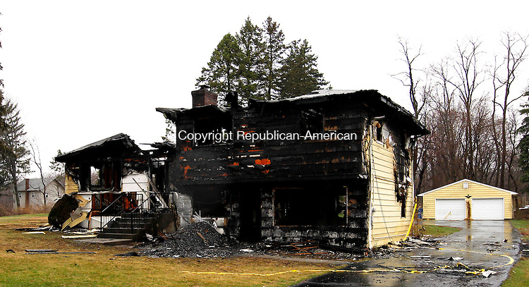 Waterbury, CT-29, March 2010-032910CM01   The ruins of the residence at 51 Matteson Road in Waterbury barely stand Monday afternoon.  The house fell to arson recently.  --Christopher Massa Republican-American