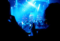 Patrons party at a nightclub.