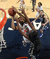 Virginia forward Sarah Imovbioh (42) shoots next to Duke center Elizabeth Williams (1) during an NCAA college basketball game in Charlottesville, Va. Duke defeated Virginia 62-41...