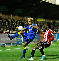 AFC Wimbledon's Lyle Taylor takes on Brentford's Romaine Sawyers during the Carabao Cup match between AFC Wimbledon and Brentford at the Cherry Red Records Stadium, Kingston, England on 8 August 2017. Photo by Carlton Myrie.