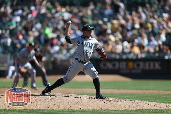 OAKLAND, CA - SEPTEMBER 30:  Erasmo Ramirez #50 of the Seattle Mariners pitches against the Oakland Athletics during the game at O.co Coliseum on Sunday, September 30, 2012 in Oakland, California. Photo by Brad Mangin