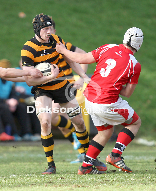 SCHOOLS CUP 2015  | Saturday 7th February 2015<br /> <br /> Charlie Fryers is tackled by Kyle Van Gieson during the third round of the 2015 Ulster Schools Cup between RBAI and Regent House at Osborne Park, Belfast.<br /> <br /> Picture credit: John Dickson / DICKSONDIGITAL