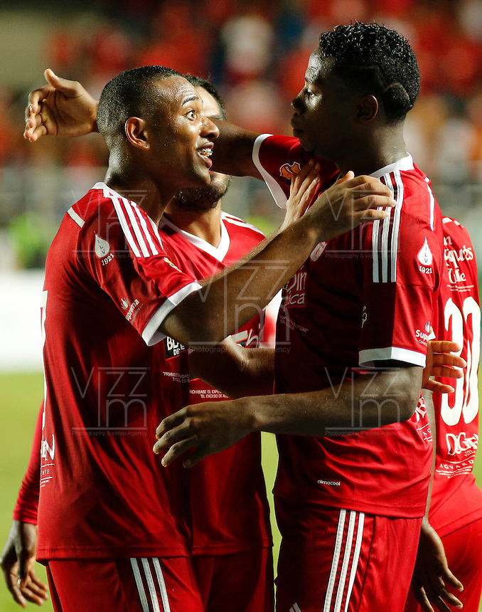 CALI -COLOMBIA-28-05-2014. Leyvin Balanta   del America de Cali celebra su gol    contra  el equipo Llaneros del Meta .Accion de juego entre los equipos America de Cali y Llaneros del Meta por el partido de ida de la semifinal del torneo Postobon en el estadio Pascual Guerrero de Cali. / Leyvin Balanta of America of Cali celebrates his goal against Llaneros of Meta. Action game between teams from America of Cali and  Llaneros of  Meta for the first leg of the semifinal of the tournament Postobon Pascual Guerrero stadium in Cali Photo: Vizzorimage / Juan Carlos Quintero / Stringer