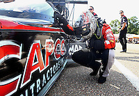Aug. 16, 2013; Brainerd, MN, USA: NHRA top fuel dragster driver Steve Torrence prays before getting into his car during qualifying for the Lucas Oil Nationals at Brainerd International Raceway. Mandatory Credit: Mark J. Rebilas-