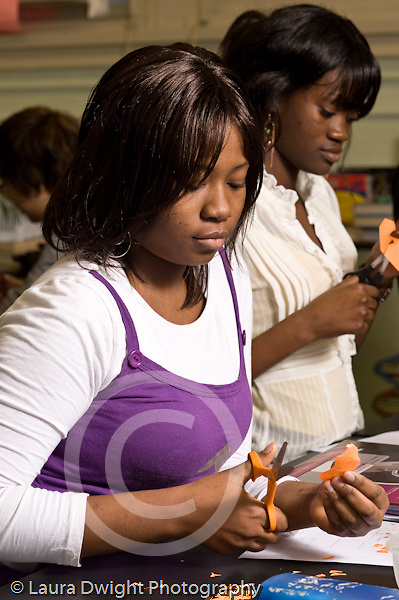 Education High School Science Biology class most students are sophmores cutting paper for chromosome models vertical