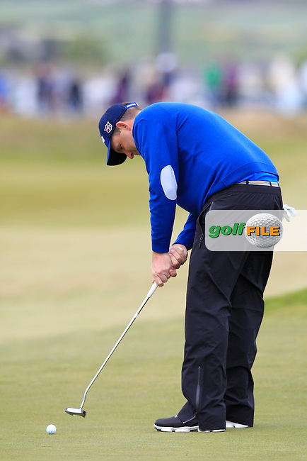 Anthony Wall (ENG) takes his putt on the 18th green during Saturday's Round 3 of the 2015 Dubai Duty Free Irish Open, Royal County Down Golf Club, Newcastle Co Down, Northern Ireland 5/30/2015<br /> Picture Eoin Clarke, www.golffile.ie
