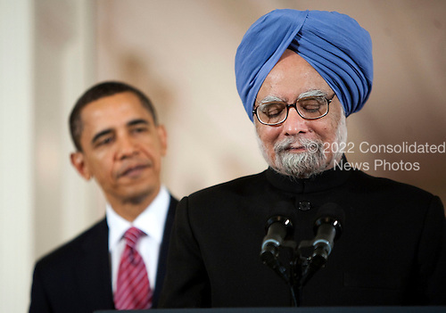 Washington, DC - November 24, 2009 -- Manmohan Singh, India's prime minister, speaks as United States President Barack Obama watches during an arrival ceremony in the East Room of the White House in Washington, D.C., U.S., on Tuesday, November 24, 2009.  .Credit: Joshua Roberts - Pool via CNP