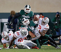 Ohio State Buckeyes running back Dontre Wilson (2) fumbles the ball on a kickoff against Michigan State Spartans during the 1st quarter at Spartan Stadium in East Lansing, Michigan on November 8, 2014.  Ohio State Buckeyes recovered the ball.  (Dispatch photo by Kyle Robertson)